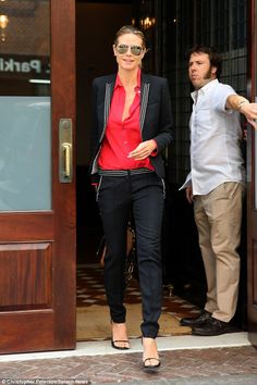 Taking on the day: Heidi Klum stepped out on Tuesday in a stylish pant suit, popping in color