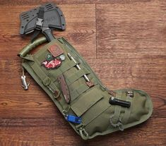 Have Santa grant all your holiday wishes by having him fill up every nook and cranny of the tactical Christmas stocking. With features like a metal clip, six strips of MOLLE, and a rack for shotgun shells, it's the ideal way for any military veteran to sp Homemade Christmas Gifts, Homemade Gifts, Diy Gifts, Holiday Gifts, Christmas Diy, Christmas Gifts For Guys, White Christmas, Birthday Gifts For Guys, Christmas Presents For Husband