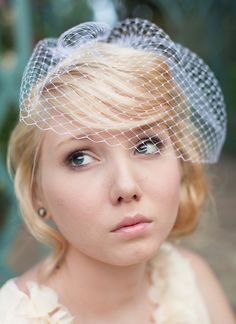 Love how this sits out a little! Love her hair too! Birdcage Veil Ivory Birdcage Veil  Blusher Veil White Birdcage Veil Black Birdcage Veil- Medium size  MADE TO ORDER. $45.00, via Etsy.