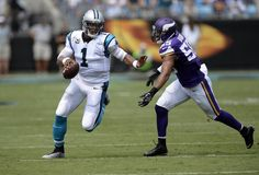 Carolina Panthers quarterback Cam Newton (1) fends off Minnesota Vikings outside linebacker Anthony Barr (55) while running upfield in the first half at Bank of America Stadium on Sunday.