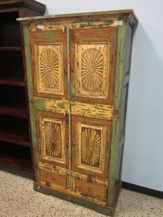 One-of-a-kind Rustic Sunburst Cabinet!  Measures: 37.5W 17D 70.5H. $712.