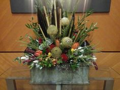 Fall arrangement with banksia protea And tropical greens Fall Arrangements, Ikebana, Wedding Designs, Reception, Tropical, Floral Designs, Plants, Stairs, Studio