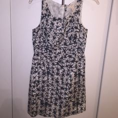JCrew starfish dress, size 8 Really cute JCrew starfish print dress size 12. Has little bows on the front of the dress and zip back. 57% cotton and 43% silk shell, 100% cotton lining J. Crew Dresses