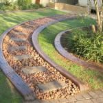 Garden edging and path with curved railway sleepers