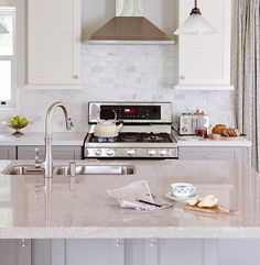 "LG Viatera Quartz Counter in Natural Limestone with Terra Verre Silver Lining 2""x4"" Tile Backsplash - Item #303254"