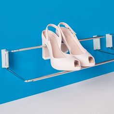 Ambos Shoe Racks can be configured a number of way. Available in either a front mount (shown here) or side mount model, you can attach a single unit to the wall or in the wardrobe, or attach a series horizontally in a long shallow space or vertically in a taller, narrower space. Guides are available that allow you to install up to 6 units with just 4 screws.