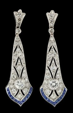 Deco Diamond Sapphire Dangle earrings set in Platinum and 18Kt Yellow Gold, featuring 54 Round Cut Diamonds for an approximate weight of 1.00ct.  The earrings are accentuated with 26 Square Cut Blue Sapphires, measure 11mm (widest point) x 41mm (long) and weigh 8.2 grams.