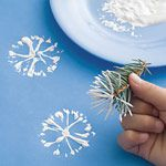 Kid-made wrapping paper -- Snowflake Stamping with Pine Needles