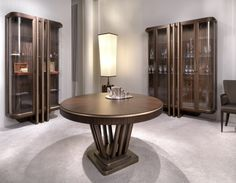 Glass doors cabinets and dining table in zebrano and silver leaf via Masha Shapiro Agency Instashop.jpg