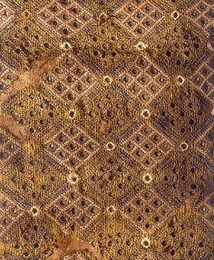 purse from Tongeren, Belgium. It is dated to 1276-1300. It exists of a woollen ground fabric with silk and metal thread embroidery. The embroidery is a mix of brick stitch and eyelet stitches