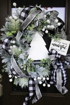 Sharing a Christmas wreath created by Kim's Kreations. You can see more images and purchase on her website. Visit the Trendy Tree blog for more stunning weaths and centerpieces. #trendytree #christmaswreath #wreathmaking