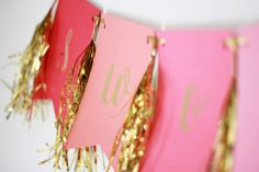 These banners are so much cuter than a poster to hang on your wall. With gold foil tassels & letters combined with colorful pennants they bring color and sparkle to any room!