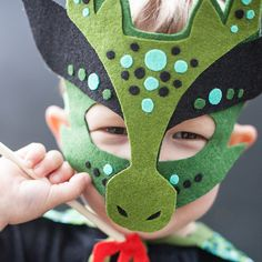 I have prepared a step-by-step tutorial to make your own Dragon costume for Halloween. I know there is one happy little dragon here in these photos.