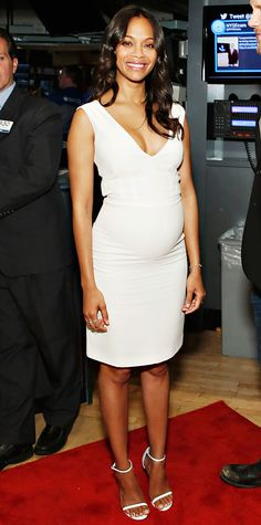 On the New York leg of her Guardians of the Galaxy press tour, Zoe Saldana's style took a turn for the classic—she wore a body-hugging LWD, complete with delicate white ankle-strap sandals. #InStyle