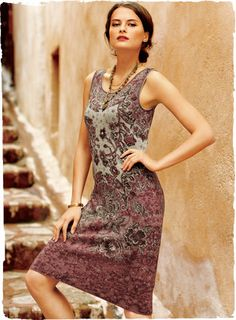 Flowers from a vintage batik are jacquard knit in rosy hues of pima. The sheath, with scoop neck and flattering fit.