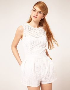 ASOS Playsuit In Broderie Anglaise. Crafted from pure cotton, with a Broderie Anglaise outer. Featuring a scoop neckline with a sweetheart detail to the inner, with a sleeveless, fitted top, a fitted waistband and pleated shorts with hip pockets. Fastened with a zip to the back.