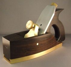 1/2 inch thick brass attached to the body by a sliding dovetail joint