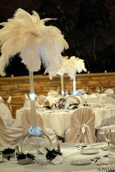Reception hall already provides this type of centerpiece so all i have to do is give them the feathers!