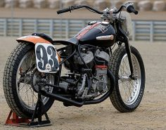 Nice Harley Davidson flat head bobber. I really love the tracker bars and set up. Look at the magneto...