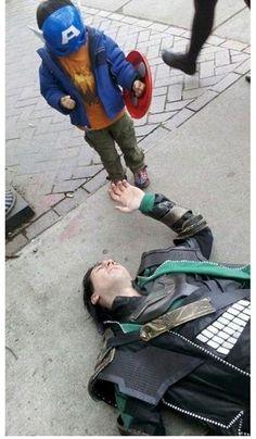 Tom Hiddleston (Loki) lets a little Captain America take him down on the set of the Advengers. Awwwwwwwww