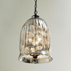 Antique Mirror Bell Pendant LanternPerfect as a lantern in the foyer or pendant in the kitchen! A classic mercury glass bell jar shaped lantern with a distinctive antique mirror finish creates a vintage-inspired glow in the foyer or in groups over a kitchen island.