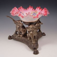 VICTORIAN CRANBERRY ART GLASS BRIDES BOWL, CRANBERRY RUFFLE TOP BOWL FADES TO WHITE, ENAMEL INTERIOR. REST ON A BASE OF SILVERPLATED ELEPHANTS