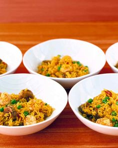 Easy Paella   Martha Stewart Living - This easy version of the Spanish favorite combines chicken, sausage, and shrimp with long-grain rice, peas, and canned tomatoes. Saffron, which usually gives paella its brilliant yellow-orange hue, is replaced here by budget-friendly turmeric.