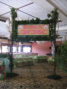 Entrance sign to a campsite event #campsite #campingtheme #linzievents #pink #outdoor #woods