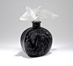 1920s I. Rice-Czechoslovakian perfume bottle, black crystal, figural frost crystal stopper. 5 1/4 in.