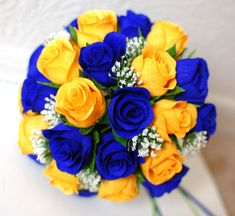yellow roses with baby's breath=good but wayyy too dark blue - need white and maybe light blue and purple??