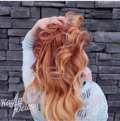 Firery red hair with balayage nude blonde ends.