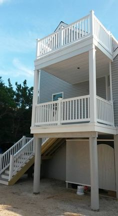 Every beach house heeds a high deck to view the sunset over the bay. Steps with a landing make the climb easy and fast. High Deck, Vinyl Railing, Trex Decking, Beach House, Pergola, Mario, Outdoor Structures, Landing, Outdoor Decor