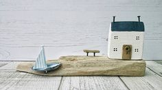 Check out this item in my Etsy shop https://www.etsy.com/uk/listing/526555630/coastal-cottage-wood-house-driftwood-art