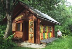 Slovenian bee shed with decorated hives. Notice the folding door in front of the hives. I'm guessing it closes during the winter.