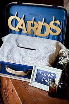 Card box, clothes pins, lace, small framed chalkboard, assorted bottles with flowers