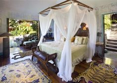 for bed __ Caribbean retreat built in 1989 for & once owned by David Bowie --  decorated in an Indonesian theme when Bowie had it built in 1989.