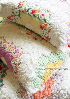 Quilt Pillows. Good way to recycle and old quilt that's all torn and tattered around the edges.