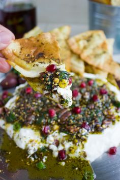 Labneh Dip with Zaatar Pistachio Mint Olive Topping. This the BEST lightest and most flavorful way to do a DIP! Use Greek yogurt for a quick substitute, and pile up the flavours: sweet, crunchy, spicy,toasty, salty--ABSOLUTELY delicious! Get the recipe for this dip, Zaatar chips and labneh from scratch! www.twopurplefigs.com