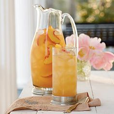 Governor's Mansion Summer Peach Tea Punch by Southern Living. This refreshing and summery Peach Tea Punch is perfect for bridal or baby showers, garden parties, and elegant teas. Party Drinks, Cocktail Drinks, Fun Drinks, Beverages, Tea Party, Tea Punch Recipe, Punch Recipes, Sweet Tea Recipes, Iced Tea Recipes