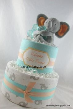 Listing is for this gender neutral diaper cake with an elephant theme. Contents: 45 Disposable Diapers (size 1) 2 Receiving blankets (30 x 30 inches) 1 9 oz bottle 1 Plush teether 1 Die cut embellishment Your baby diaper cake arrives wrapped in tulle, adorned with matching