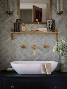 tiles from the winchester tiles company. Love the tiles, grout and faucets coming out of the wall.