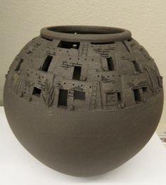Kriston Mognett Ceramic Studio Artist. Hand carved pueblo vases. Details include ladders, exposed rock, cacti, & pots.