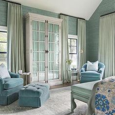 Green and Blue Bedroom Sitting Space with Light Gray Glass Front Armoire