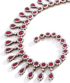 An Antique Ruby and Diamond Necklace Circa 1890. Pear-shaped and round rubies weighing approximately 78.00 carats framed by old mine diamonds weighing approximately 48.00 carats mounted in silver-topped gold length 15 inches. #antique #necklace