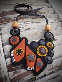 **This marvelous felted piece of artwork is created to be worn and has been inspired by the pattern found on monarch butterflies. Felt Necklace, Fabric Necklace, Fabric Jewelry, Pearl Necklaces, Rope Jewelry, Geek Jewelry, Gothic Jewelry, Jewelry Bracelets, Fashion Jewelry