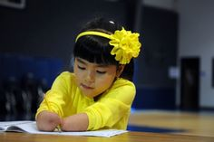 Cute Kid of the day wins penmanship award with no hands