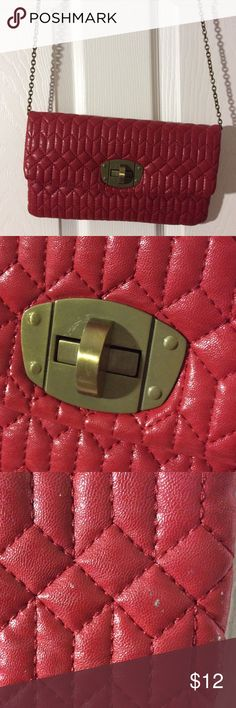 Red envelope clutch crossbody This beautiful red quilted bag doubles as a crossbody or clutch. It has a removable brass chain. Faux leather with faux suede interior. Interior zip pocket. Great condition aside from scratches on brass hardware (see second photo) and silver spots across the entire back of bag (see third photo). Not terribly noticeable. Under One Sky Bags Crossbody Bags
