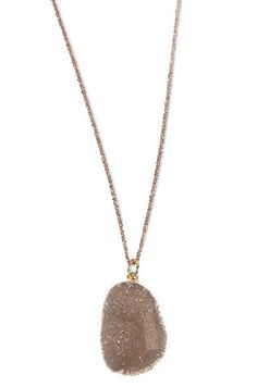 Petite Freeform Druzy & Rose Gold Necklace   Like a glistening bud, the Petite Freeform Druzy is wrapped in gold and suspended from a delicate rose gold diamond-cut chain. This necklace adds a subtle touch of shimmer to your look.