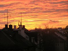Morning over the roofs of Olomouc dressed in the hoods of clouds of purple and gold.