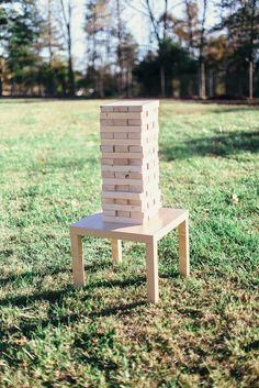 Giant Jenga lawn game at the cocktail hour before the reception at our #rustic #barn wedding. From Tumbling Tower Shop on Etsy.